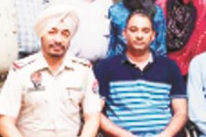 two policemen  including four others  were arrested