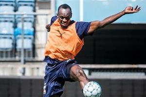 bolt arrives australia with dream of becoming professional footballer