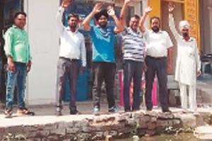 shopkeeper distraught due to sewerage