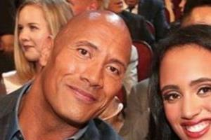 hurriedly wwe the rock  s daughter simone looks into the ring
