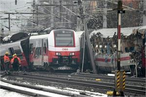 train crashes into bus in austria  one dead