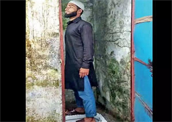 mp in groom picture standing inside of toilet