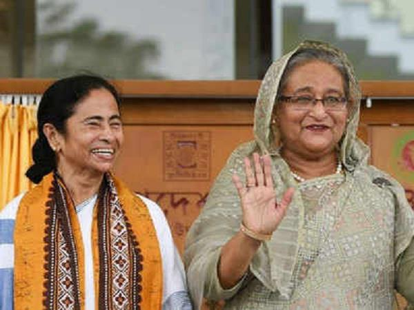 mamata and hasina play together to ring the bell in eden
