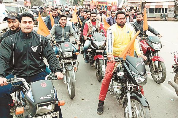 rashtriya swayam sevak sangh draws a motorcycle rally
