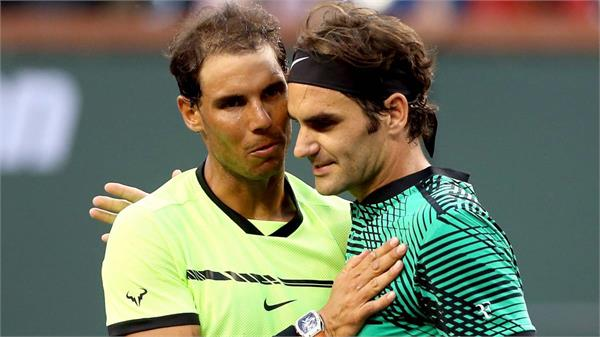nadal federer set up potential semifinal at french open