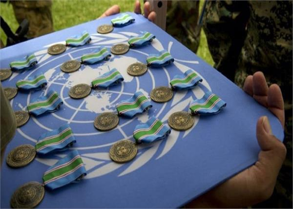 un peacekeeping officer gets 119 medal