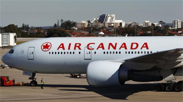 air canada flight s emergency landing 35 passengers injured