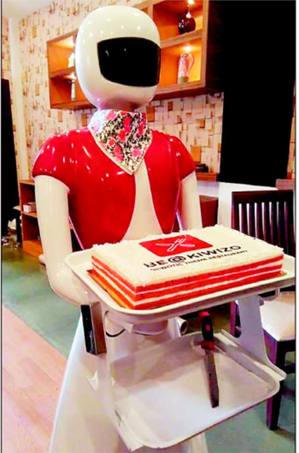 kerala restaurant serves   robot waitresses   food