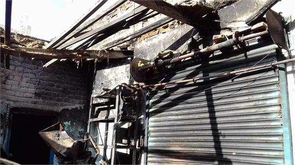 fire exits the shop by dropping petrol