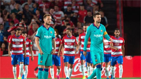 a poor start to barcelona  losing to granada 0 2