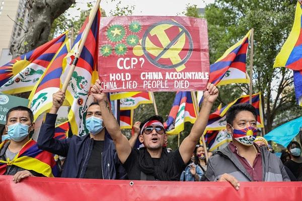 demonstrations in london and tokyo china  s national day