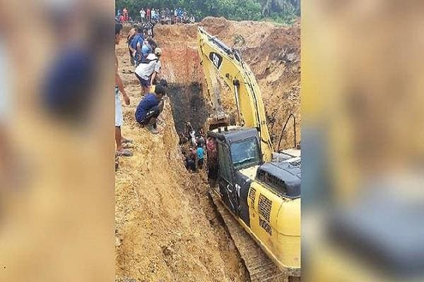 indonesia coal mine dead bodies collect with machine