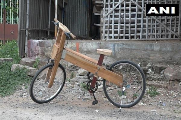 tamil nadu father son wood bicycle