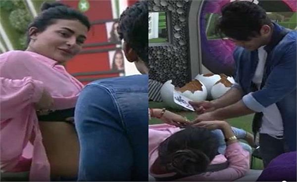 bigg boss 14 sidharth shukla turns tattoo artist and sara gurpal