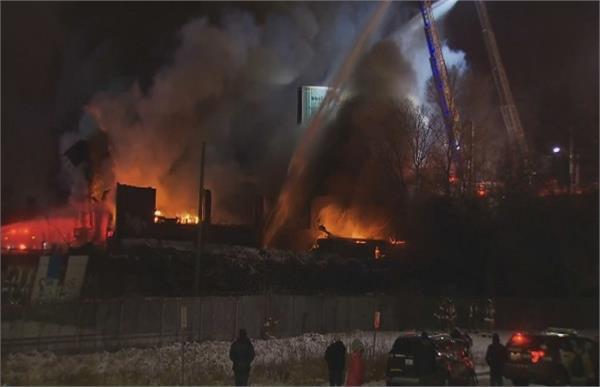 fire crews battle 5 alarm blaze at abandoned building