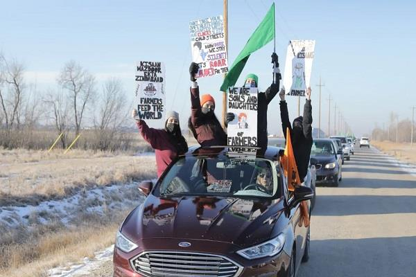 hundreds take part in winnipeg rally protesting farmers