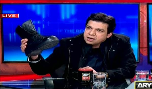 ban on minister who showed boot at live tv show in pakistan