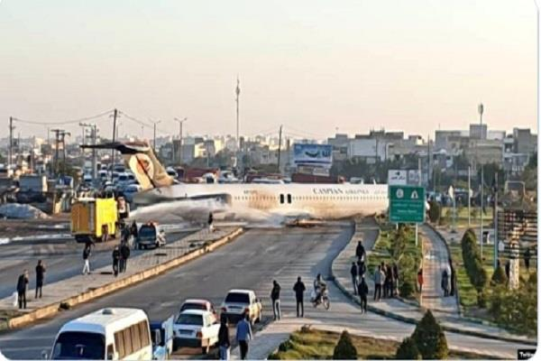 iranian airliner skids into street