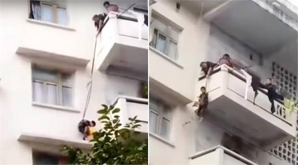 woman dangles 7 year old grandson from balcony to rescue pet cat