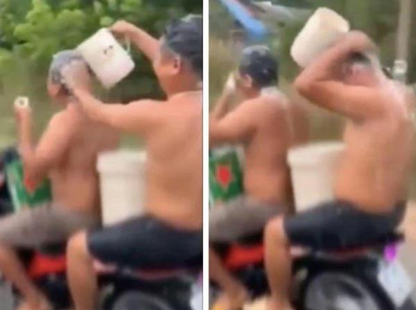 vietnamese police fine men filmed showering while riding