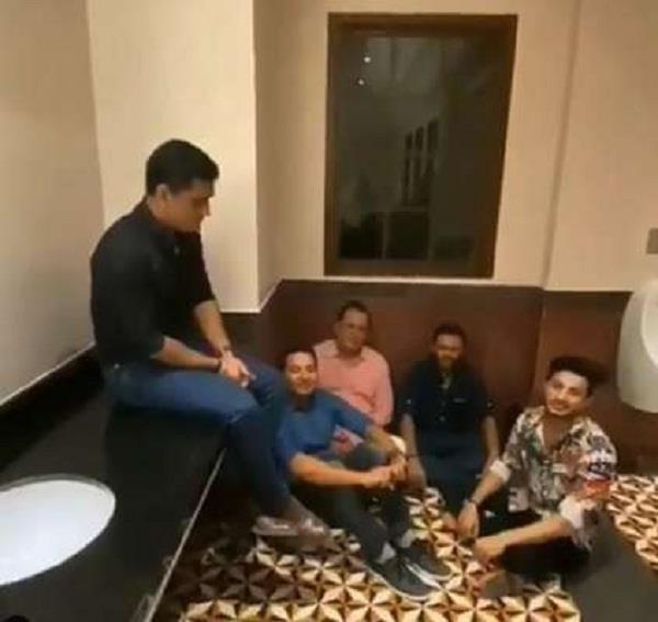 watch dhoni  s friends sing while sitting on the floor of the bathroom  video