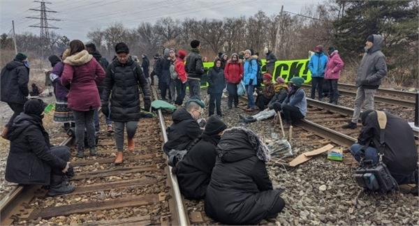protesters block the canadian rail tracks in west toronto