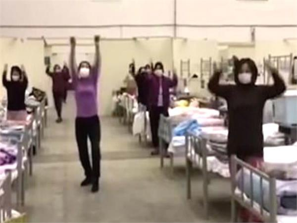 coronavirus  patients perform dance and exercise in hospital to stay fit