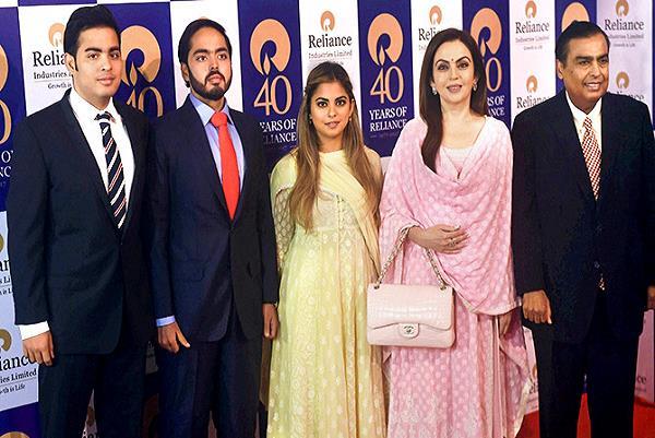 mukesh ambani family raises stake in ril  shares up 4