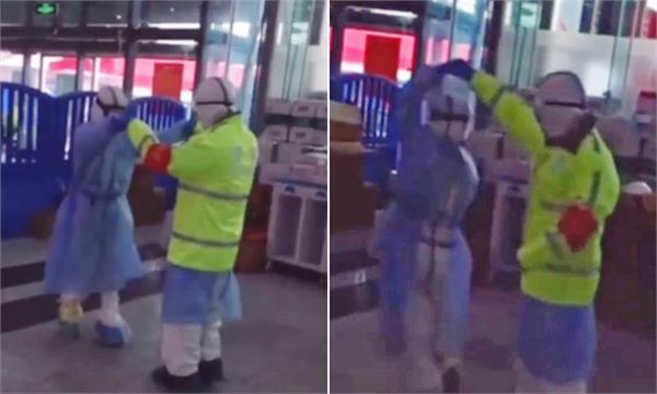 coronavirus  police officer and nurse dancing in wuhan city  china