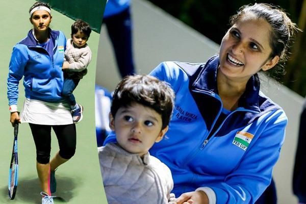 sania mirza arrives at the tennis court with her son on her lap