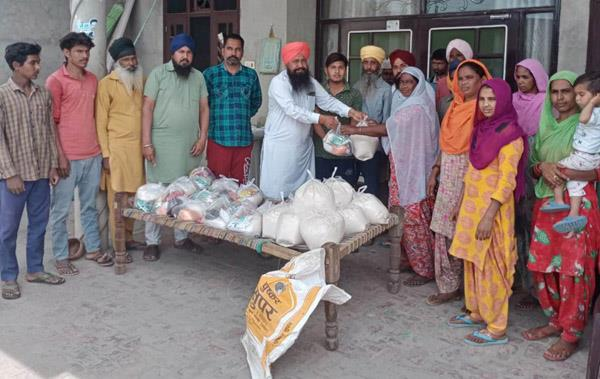 nri labh singh provides ration kits for the needy in the village