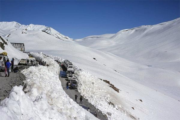 snowfall on high peaks including rohtang pass