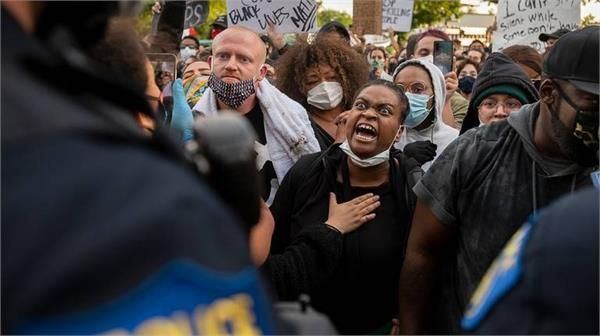protests in 30 us cities over black deaths  2 deaths