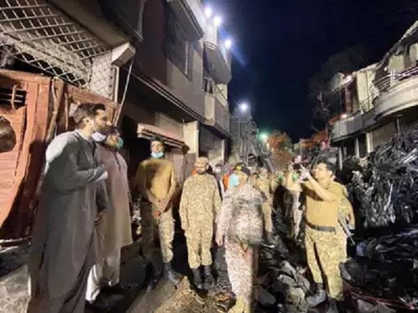 afridi arrives at the crash site to be photographed surrounded in pak
