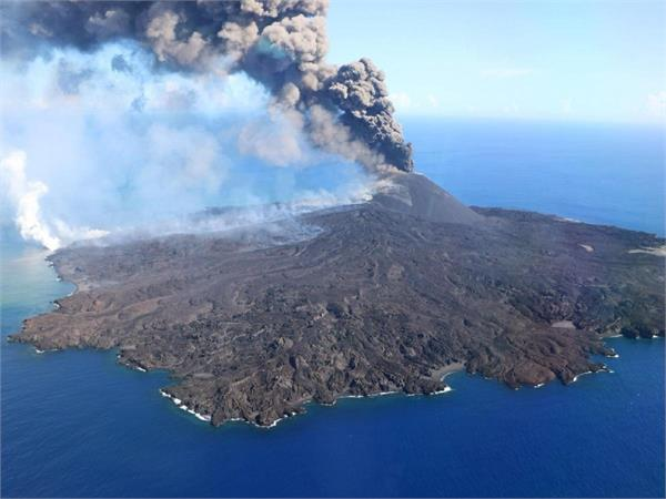 a volcanic eruption  a new island formed by lava