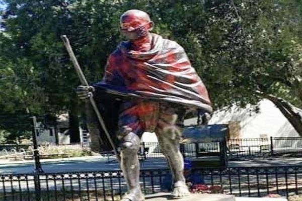 paint on statue of mahatma gandhi california