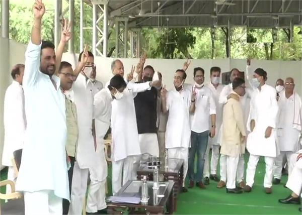 rajasthan  ashok gehlot party mlas show victory sign