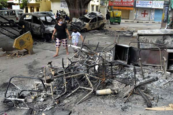 flare up in bengaluru  250 vehicles burnt  3 killed in police firing
