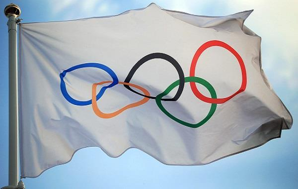 holding the olympics will be a symbol of victory over the virus  japanese pm