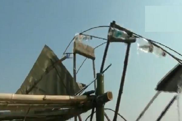farmer irrigation help waterwheel instrument salute