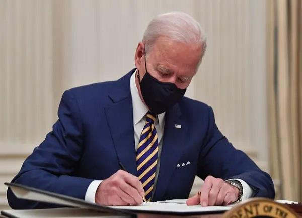 biden signs order for economic relief to americans