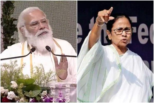 tmc complains to election commission over pm s photo on vaccine documents