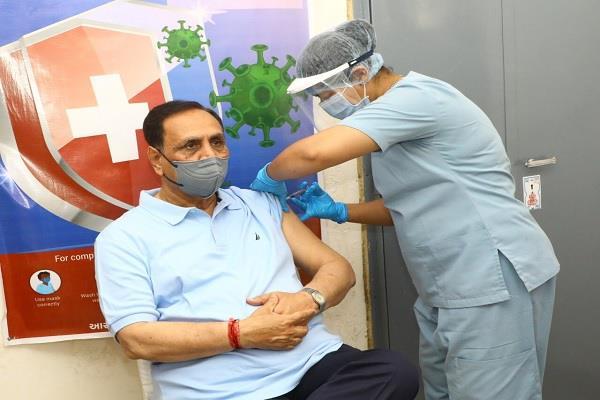 gujarat cm vijay rupani corona vaccine first dose