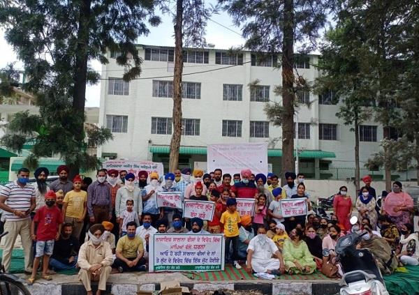 parents protest in front of school