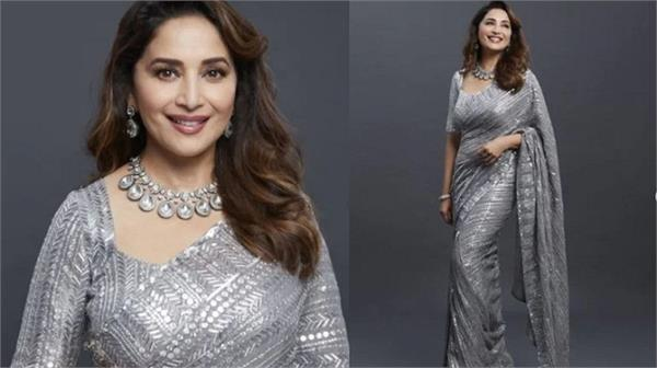 covid vaccinated madhuri dixit is  back on set  in a shimmery silver saree