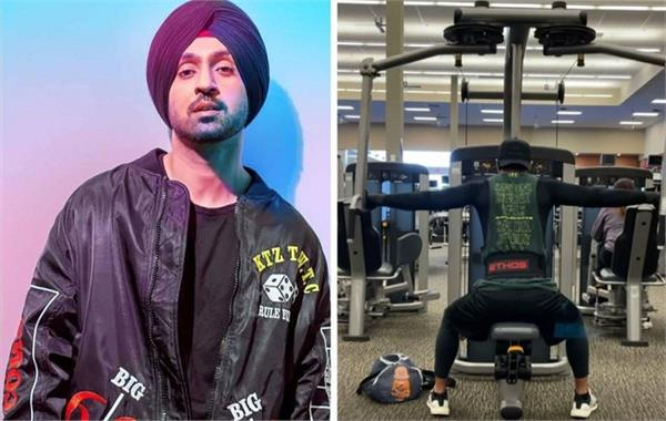 wearing a black and grey gym rig diljit dosanjh seen doing back exercises