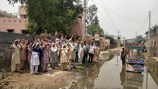 hell like situation caused by sewage water  protests by people