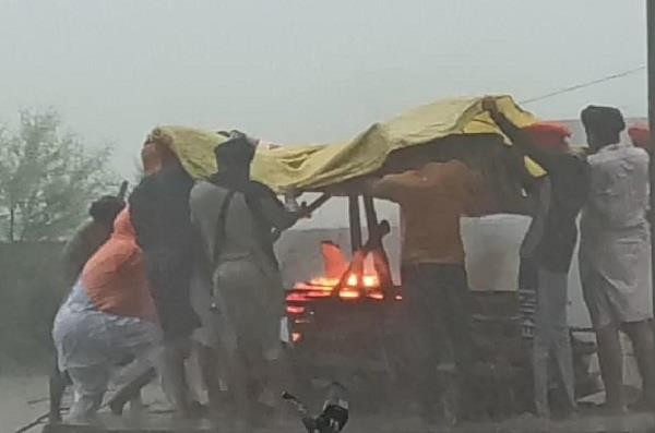 light rains punjab government claims open poll  tarpaulins had to be cremated