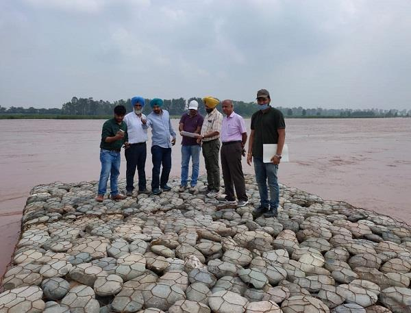 chief engineer assesses the situation of the river at sensitive places
