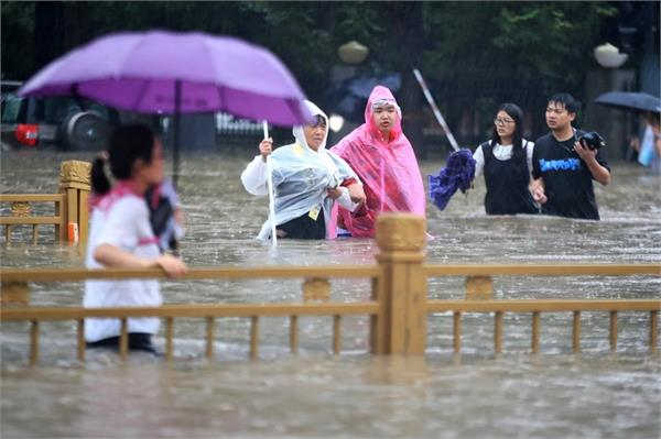 33 dead in china s flood hit henan